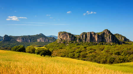 Beautiful blue sky over the limestone formations of Ogliastra, Sardinian dolomite formations. Nature of an unspoiled landscape. Standard-Bild