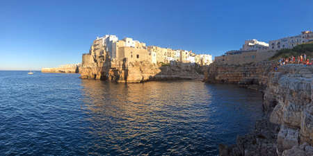 Polignano a Mare panorama on Mediterranean sea and cliff at sunset, Puglia, Italy