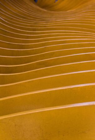 saturated color: Abstract yellow waves; good photo for a background, for example on a phone or on a tablet