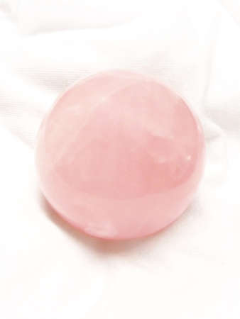 Pink color crystal ball on the white background  Stock Photo