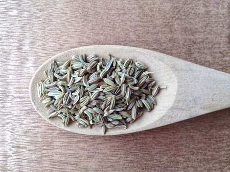 Cumin seeds in the spoon. Stock Photo
