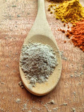 Pepper power in wooden spoon.
