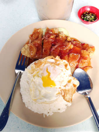 Sweet and sour chicken chop rice with egg  Stock Photo