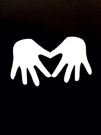 Paper cut forming love shape Stock Photo