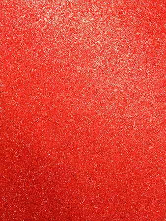 Red color glitter paper texture.