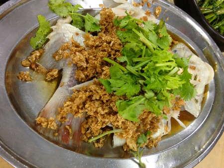 Tilapia fish steam salted turnip