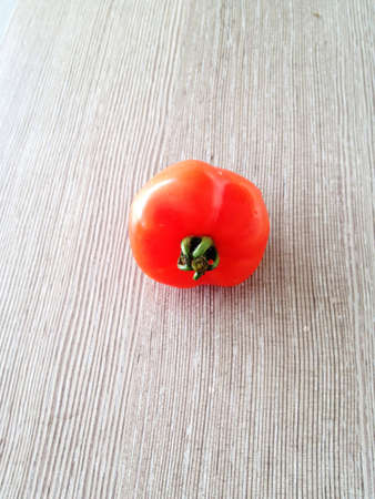 Love shape tomato on Maica wood texture