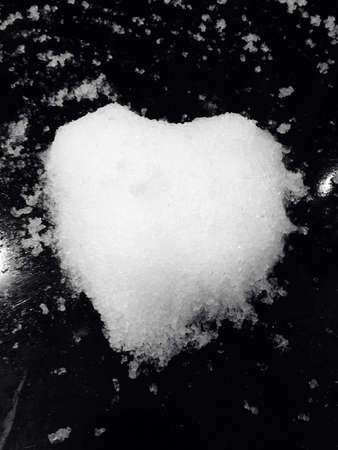 Magic snow forming love shape Stock Photo