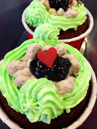 Cupcake cream with love shape.