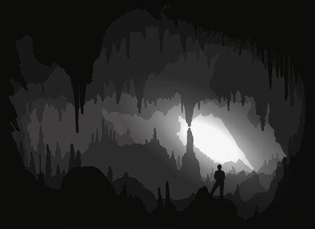À l'intérieur d'une cavité rétroéclairée avec des stalactites et des stalacmites