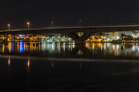 Pontevedra City wakes up in color lights for a new day Highway crosses the river.
