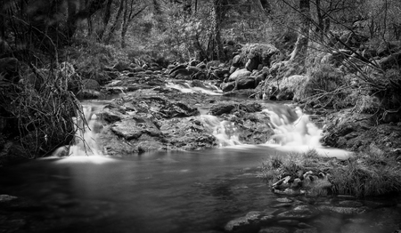 Rivers Stones. Long exposure shot at daylight with Hoya ND 10 steps. Black and white with vignette Banco de Imagens