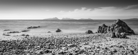 Daylight panorama view from Patos beach in Nigran, Galicia. Cies Islands watching over like a sentinel. Black and white. Long exposure daylight shot