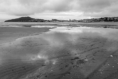 Reflections in low tide in black and white Banco de Imagens
