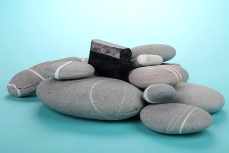 obsidian over rocks photo