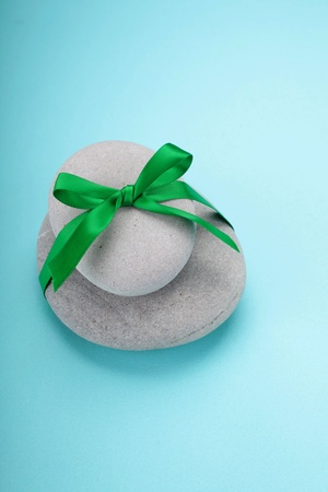 stack of rocks wrapped in green ribbon photo