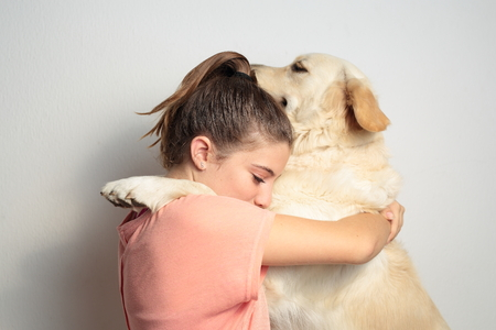 golden retriever: Teen playing with her dog Stock Photo