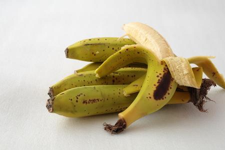 naturist: Bunch of ripe bananas isolated on white Stock Photo