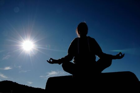 woman meditating: Woman meditating after doing yoga
