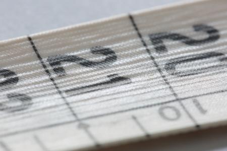 metro medir: Flexible measuring meter of fabric photographed close Foto de archivo