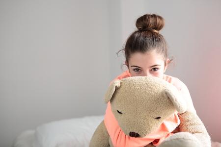 sexy girl: teen hugging her teddy bear