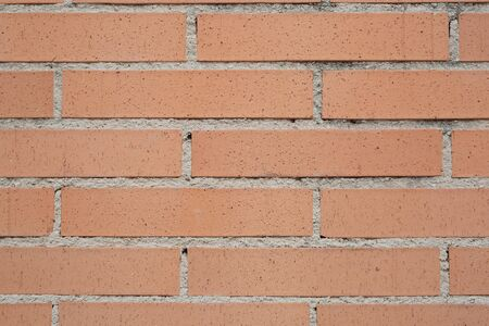 facing a wall: Facing brick wall background colored clay