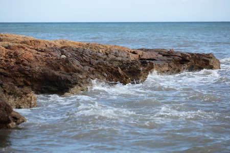 storm tide: rock beach in Santa Pola, Alicante, Spain Stock Photo