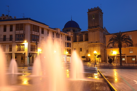 santa maria: Elche, Spain - February 3, 2016: Eucharistic Congress Square dusk, with the Basilica Santa Maria at the bottom of the image.