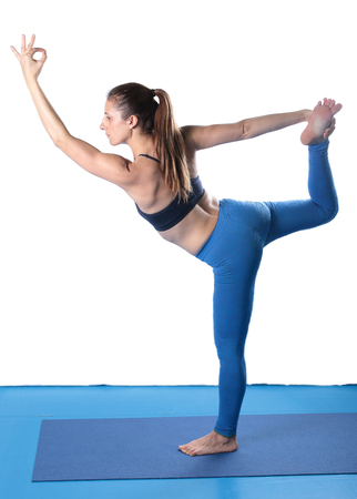 floor mat: Woman practicing yoga on the floor on a blue mat and white background