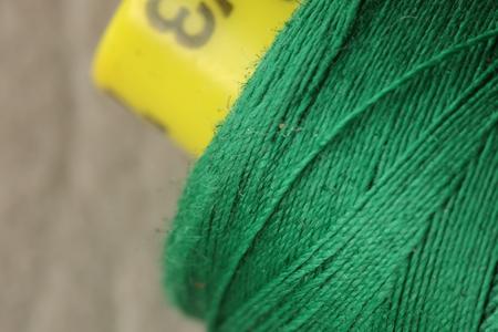bobina: bobina de hilo verde macro