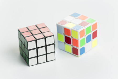 rubik: Elche, Spain. May 26, 2016: Two rubik cubes on a background of white