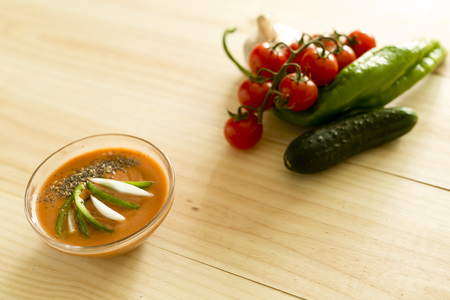 gazpacho: Andalusian gazpacho with ingredients on a wooden background pine