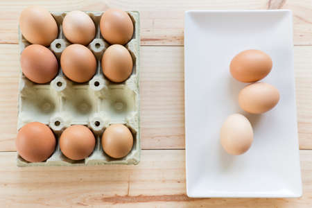 egg cup: Chicken eggs in an egg cup with a square white plate