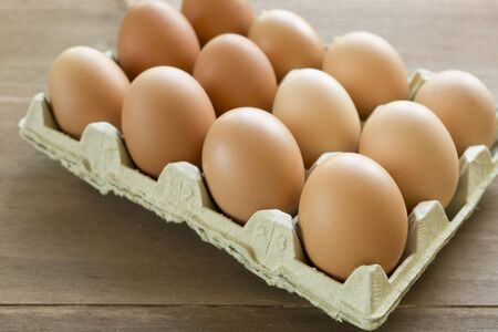 egg cup: Chicken eggs in an egg cup on a wooden background