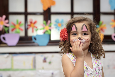painted face: girl with painted face at a party Stock Photo