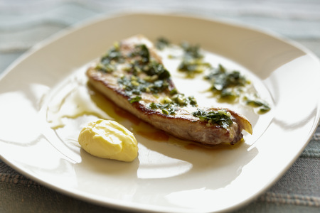 Grilled swordfish with garlic sauce and perjil