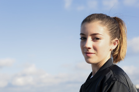 lass: Teenager on the roof of a building. Natural daylight, horizontal  shoot