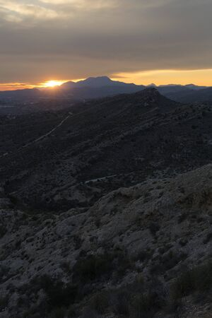Sunset in the mountains of Elche province of Alicante in Spain. Vertical shot