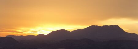 Sunset in the mountains of Elche province of Alicante in Spain. Panoramic horizontal shot Foto de archivo