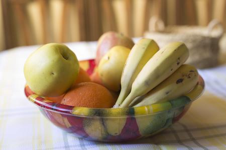 Fruit bowl with several fruits. Selective focus Natural coluze and horizontal shot. Stock Photo