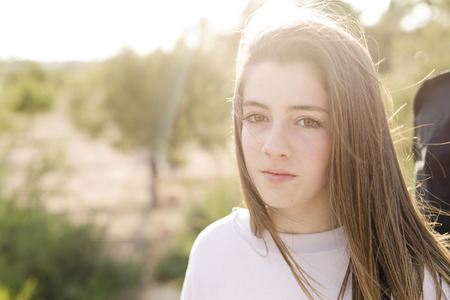 Portrait of a 15 year old teenage girl photographed in backlight