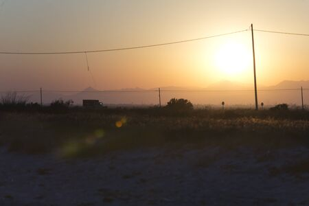 anochecer: Sunset in Santa Pola with a flare effect, Alicante province in Spain.
