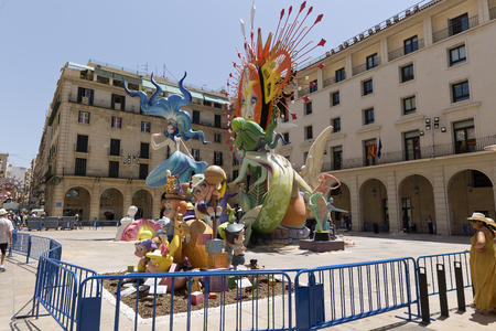 illustrative editorial: Alicante, Spain. June 20, 2017: Image corresponding to the official bonfire of the town hall square. Artwork by artist Pedro Espadero and his team.Today they finish putting the last details, in the day denominated the plantá. It advances the plant of t Editorial