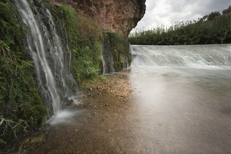 Small waterfall beside the river world as it passes through Lietor, Spain