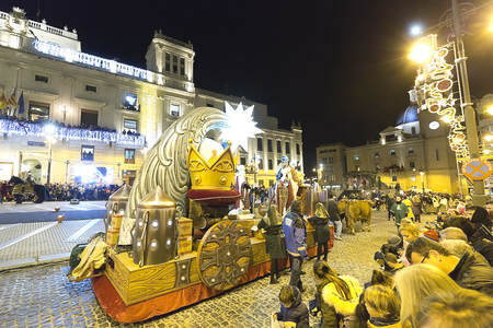 Alcoy, Spain. January 5, 2018: Cabalgata de los Reyes Magos in the city of Alcoy. It is the most anticipated event for children throughout the year. A Festival of National Tourist Interest that brings together hundreds of visitors every year who want to l Editorial