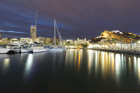 Alicante, Spain. February 9, 2018: Views of the Port of Alicante and the city during a cold winter sunset. Editorial