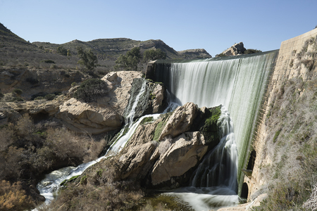 Elche Reservoir is a gravity dam in the shape of an arch
