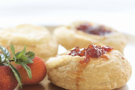 Goat curl puff pastry with caramelized pepper. Image made with natural and horizontal light