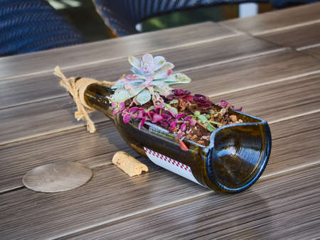 Centerpiece of wine bottle with flowers
