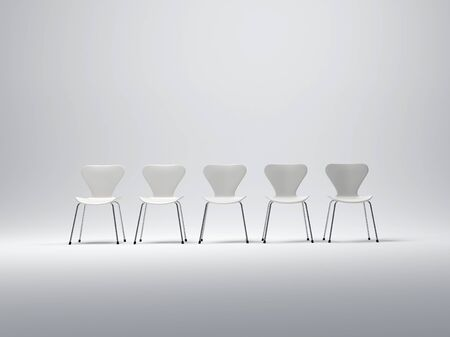 Row of five white plastic and metal chairs in a neutral background photo